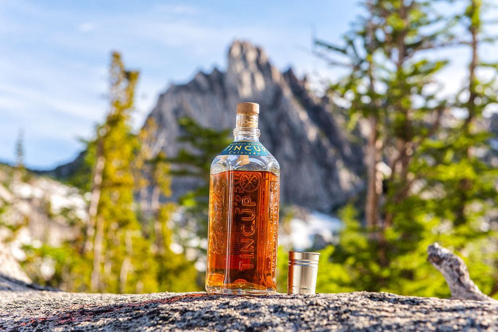 austin-trigg-whiskey-enchantments-washington-product-mountain-background-bottle.jpg