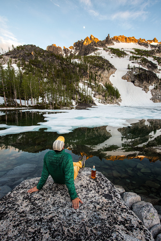 austin-trigg-whiskey-enchantments-washington-product-Sitting-campsite-lake.jpg