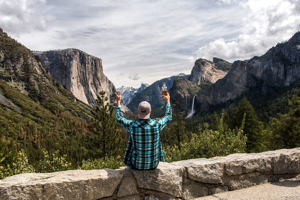 austin-trigg-whiskey-yosemite-product-TINCUP-Tunnel-View-Daytime-raise-hands-shot-glass-bottle-valley.jpg