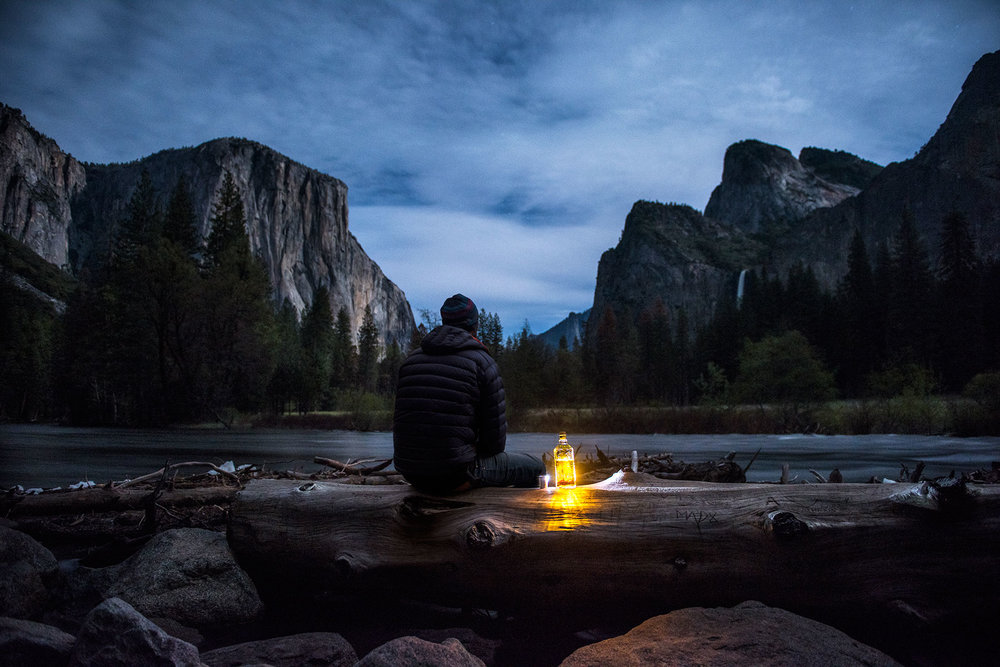austin-trigg-whiskey-yosemite-product-TINCUP-Valley-View-glowing-bottle-log-merced-river.jpg