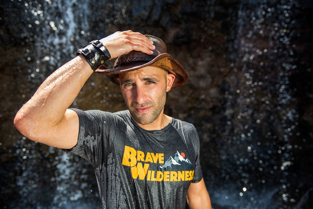 austin-trigg-brave-wilderness-kauai-hawaii-coyote-peterson-hat-waterfall.jpg