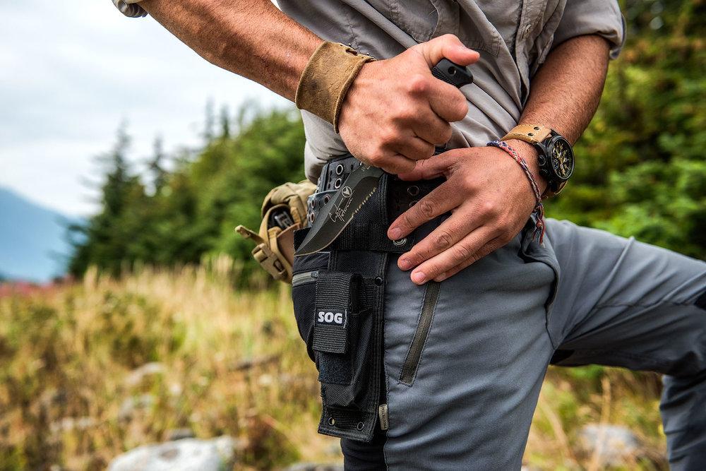 austin-trigg-brave-wilderness-alaska-BW-Coyote-Pulls-Sog-Knife.jpg