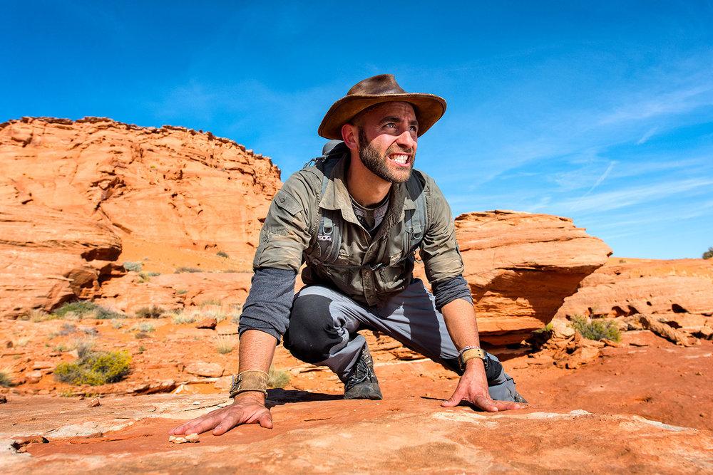 austin-trigg-brave-wilderness-utah-zion-Coyote-peterson-Crouched-Dunes-cliff-desert.jpg