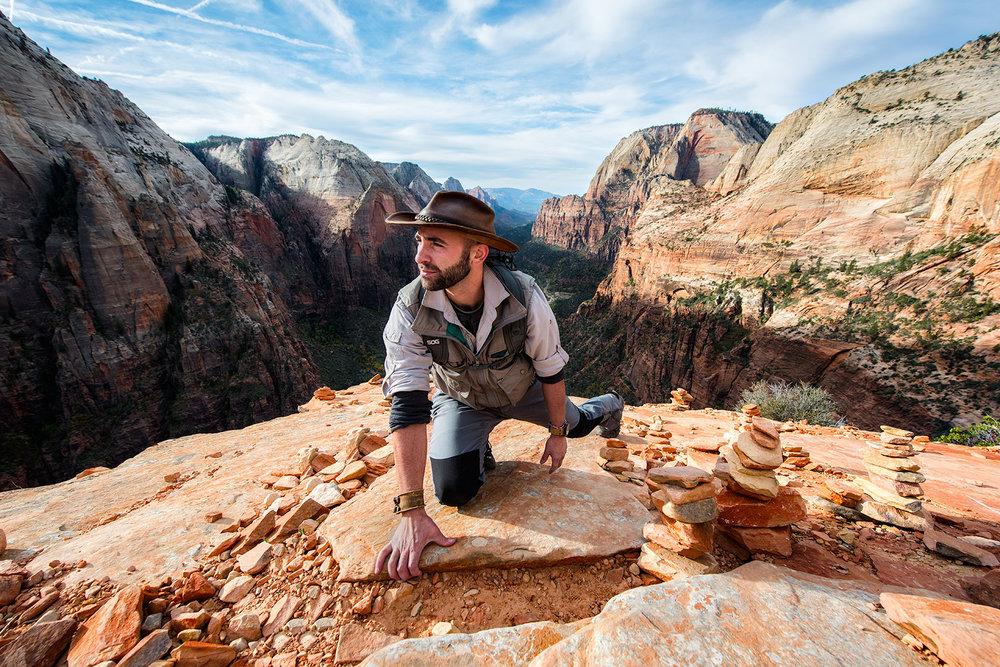 austin-trigg-brave-wilderness-utah-zion-Coyote-peterson-grabbing-rock.jpg