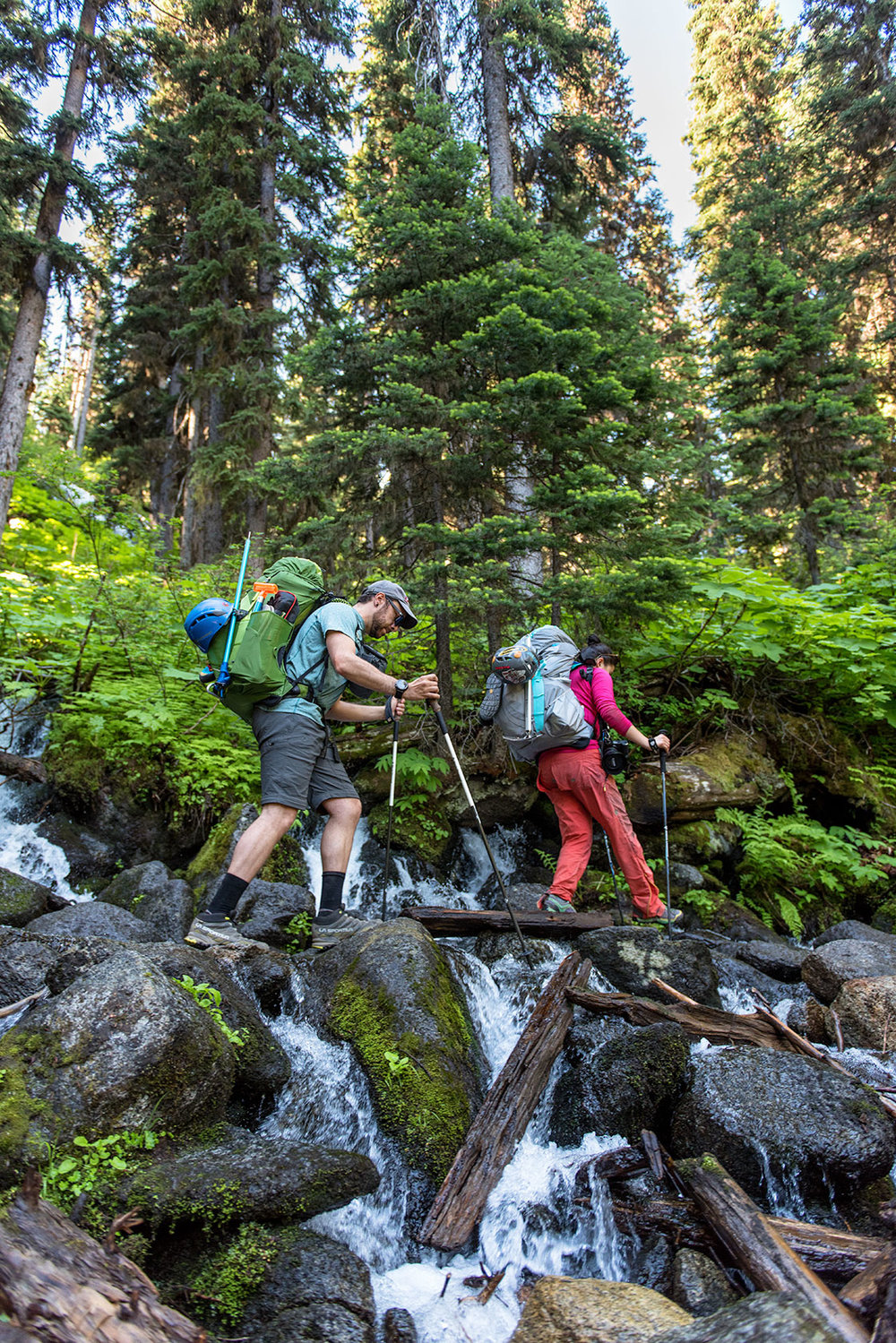 austin-trigg-osprey-hiking-backpacks-hike-camp-washington-adventure-morning-sunrise-lifestyle-outdoor-enchantments-stream-crossing-forest.jpg