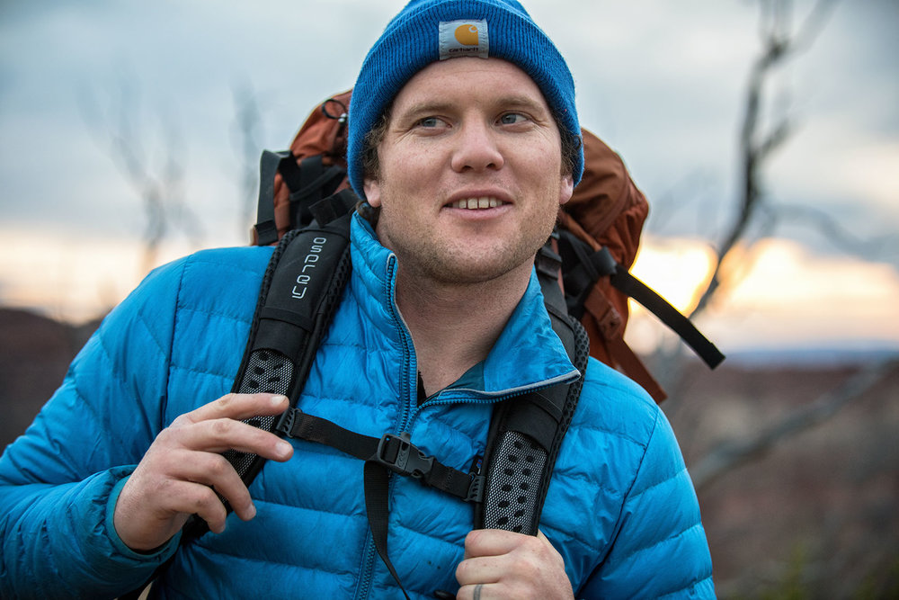 austin-trigg-osprey-hiking-backpacks-grand-canyon-osprey-pack-bag-arizona-hike-camp-model-lifestyle-camp-product-adventure.jpg