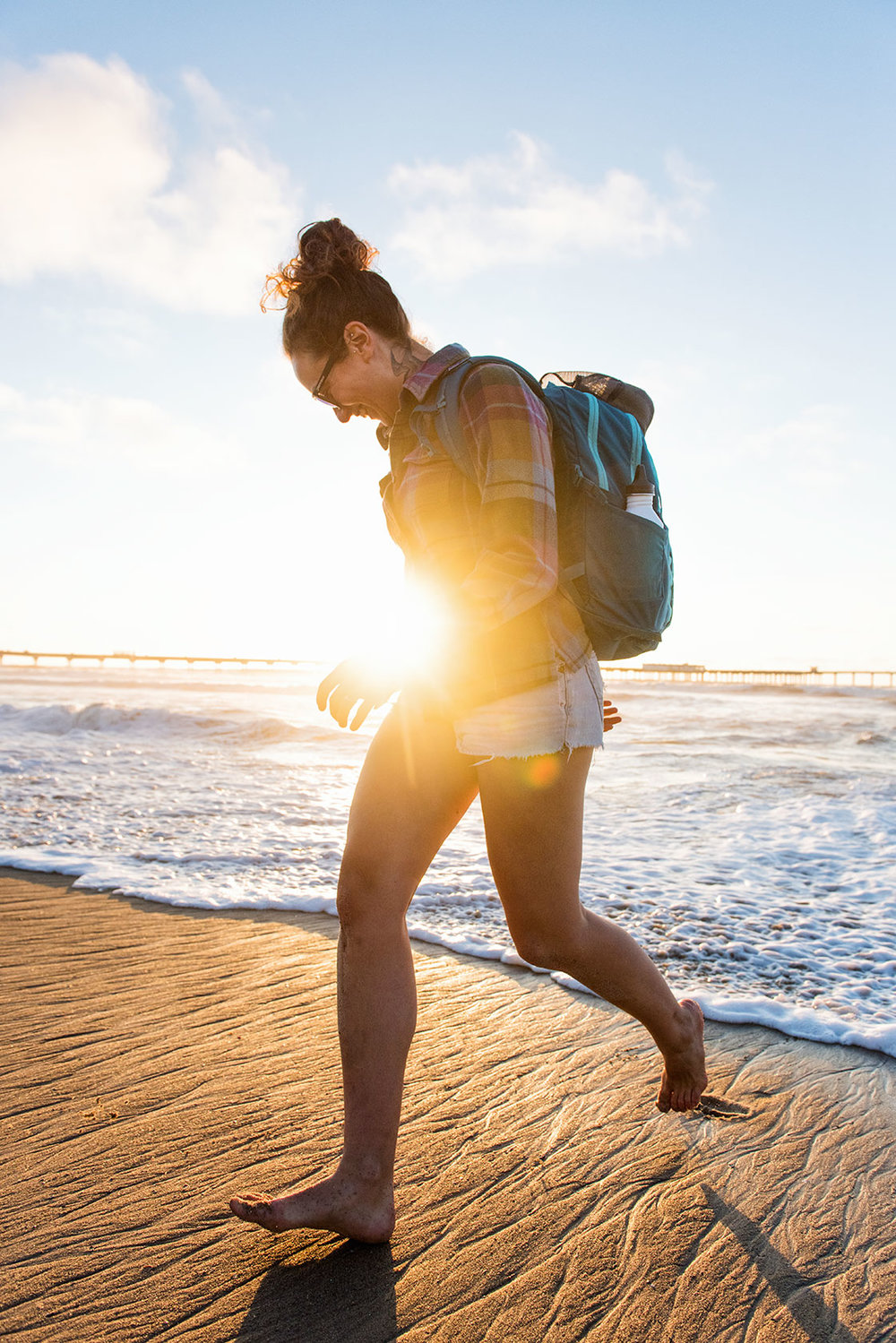 austin-trigg-patagonia-day-pack-southern-califronia-lifestle-product-backpack-adventure-pier-ocean-wave-sunset-running-sun-flare.jpg