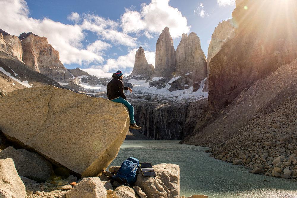 austin-trigg-patagonia-adventure-hiker-sits-at-torres-del-paine-mountains-lake.jpg