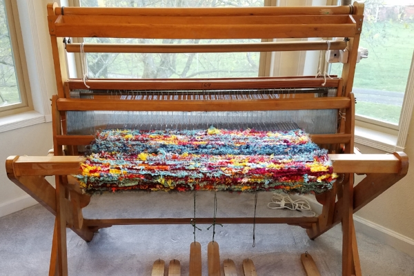 Kathy's loom, churning out another colorful handmade rug.  Click  to see more!