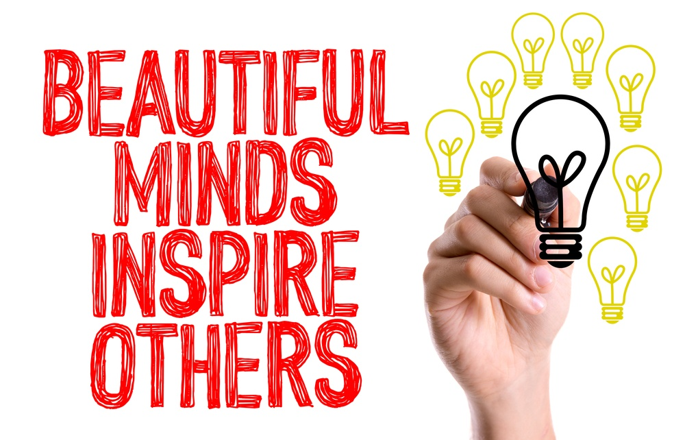 Hand with marker writing the word Beautiful Minds Inspire Others.jpg