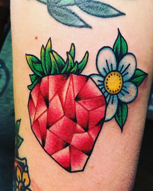 Deliciously awesome jewel strawberry by @dylandonohue_tattoos Looks so tasty! #strawberrytattoo #flowertattoo #traditionaltattoos #fullcolortattoo #sanantoniotattooartist #sanantonio #fortunebros