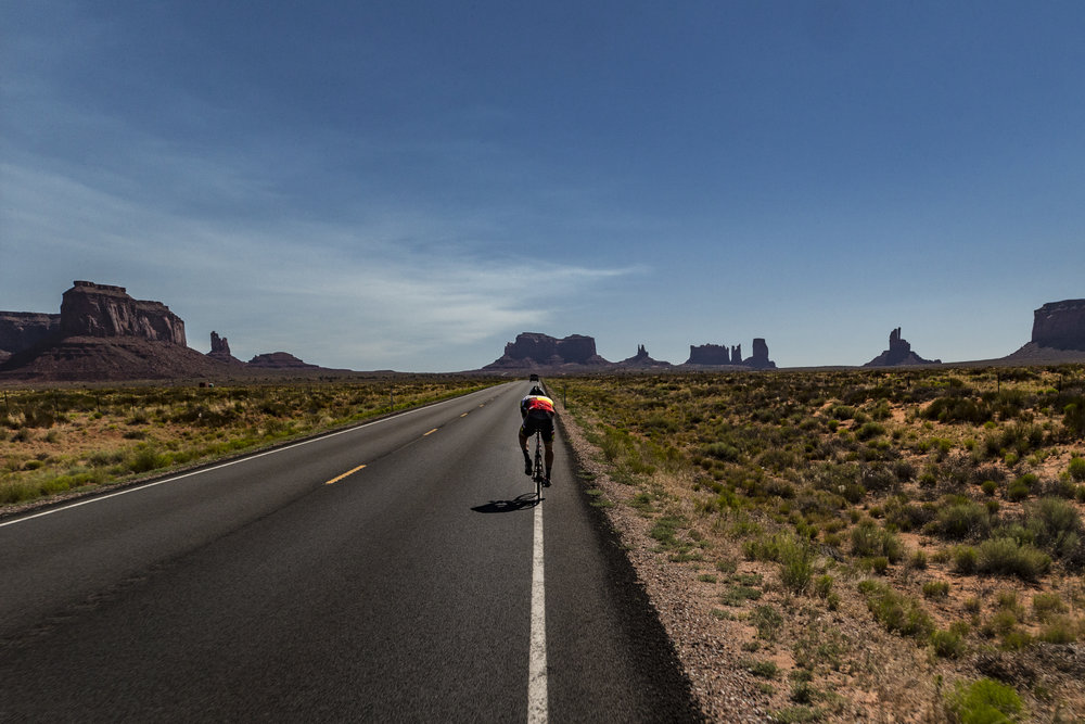 Road cyclist riding in the desert