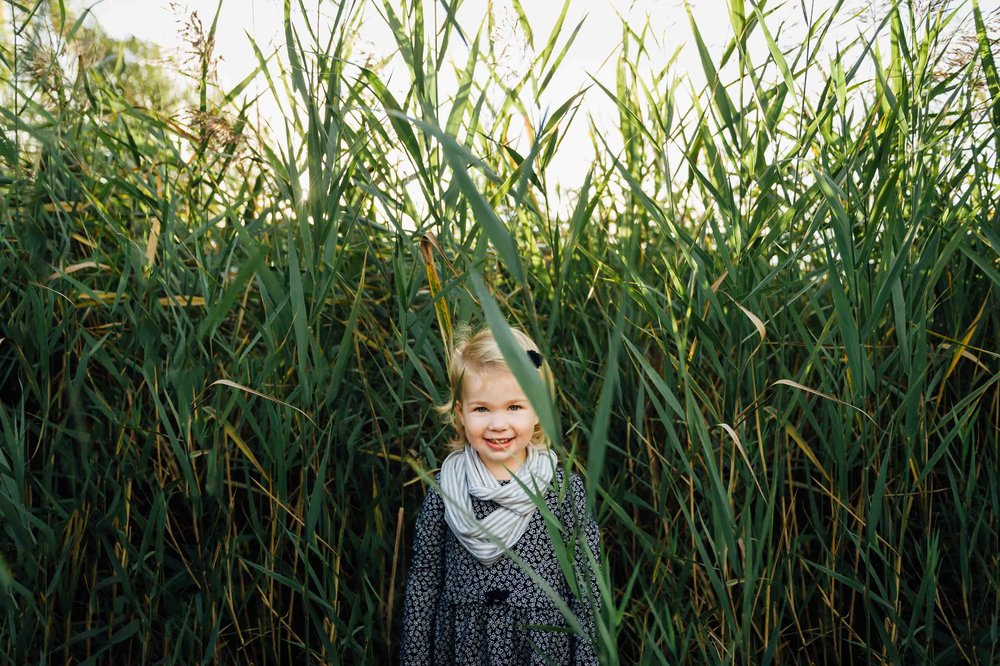 girl standing in tall grass - Niagara lifestyle family photographer