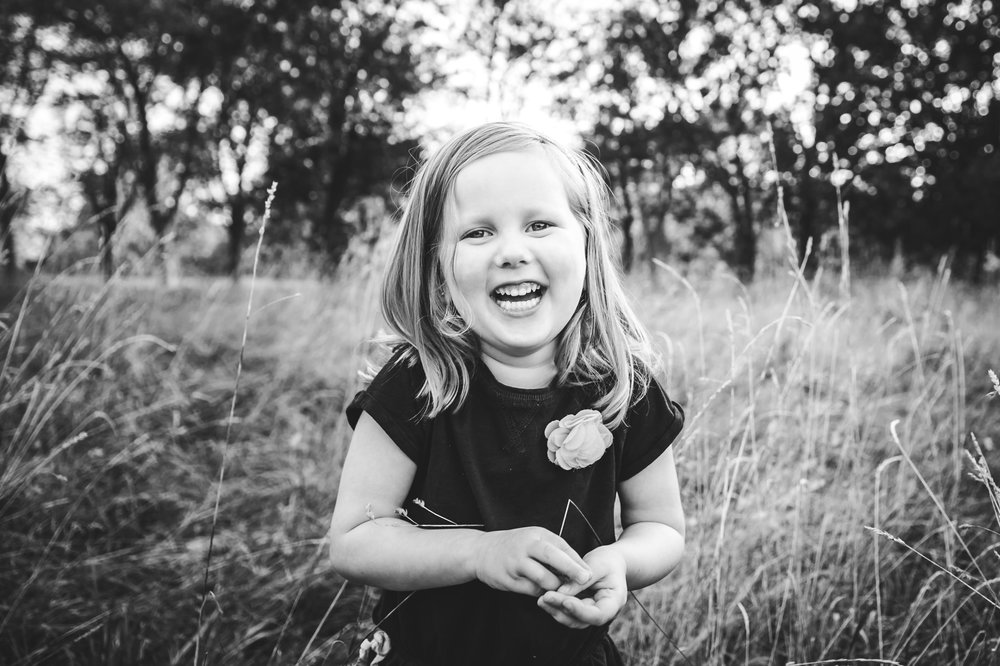 girl laughing in field candid moment - niagara child photographer