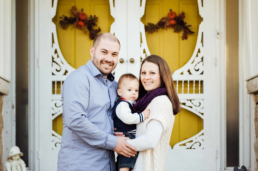 family with boy on front steps of family home - St Catharines family photographer