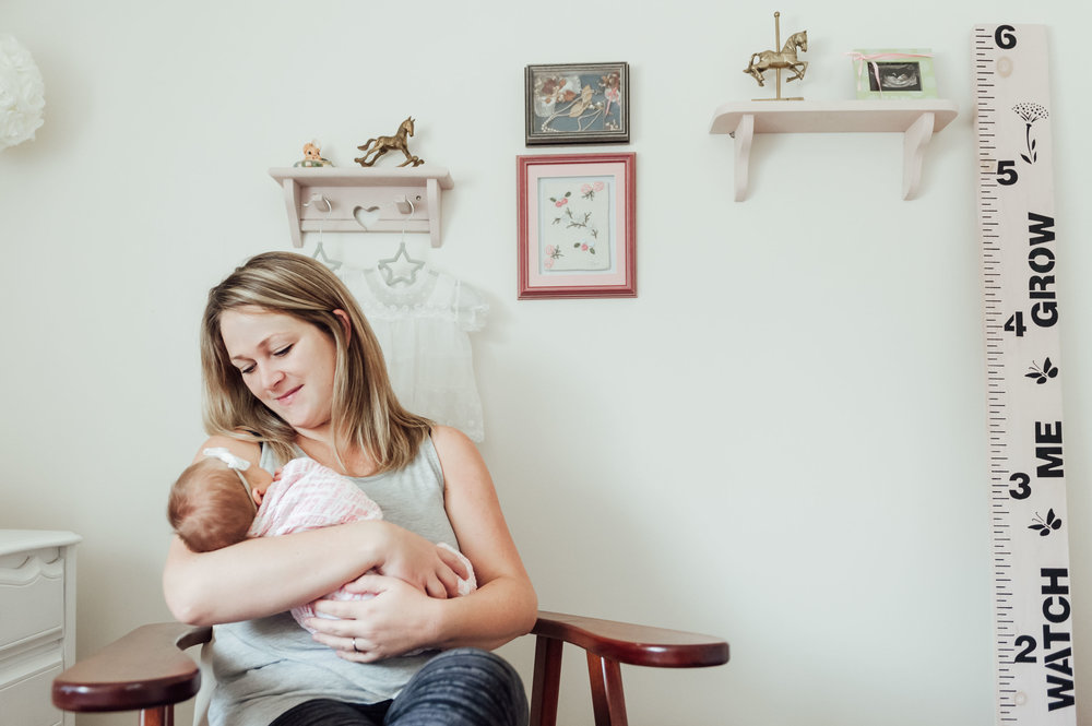 mother in rocking chair with baby girl - Niagara baby lifestyle photographer