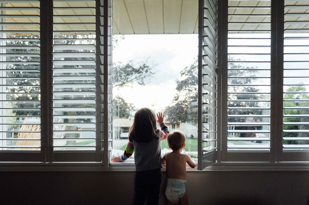 children looking out window - niagara in home photography