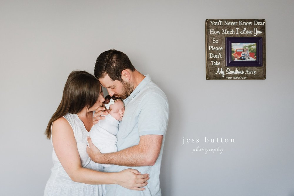 baby in parents arms at home - Fonthill - Niagara Newborn Photography