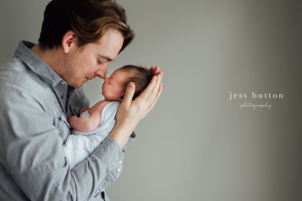 father nose to nose with baby girl - studio lifestyle | 8 day old baby girl | Niagara Falls Newborn Photographer