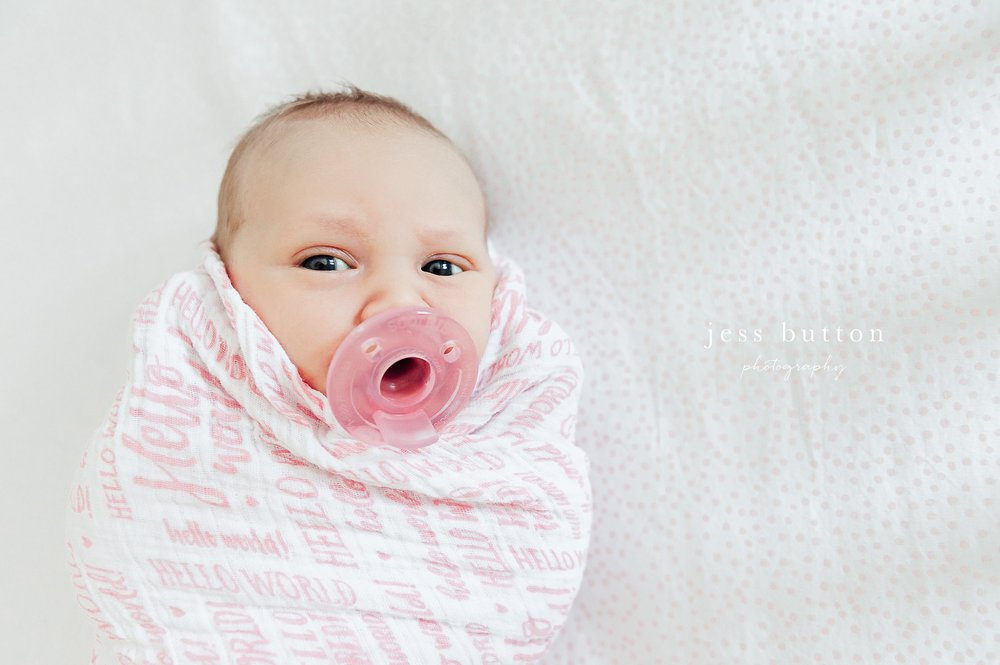 niagara newborn photographer - St Catharines baby photos - 8 day old girl swaddled awake in crib