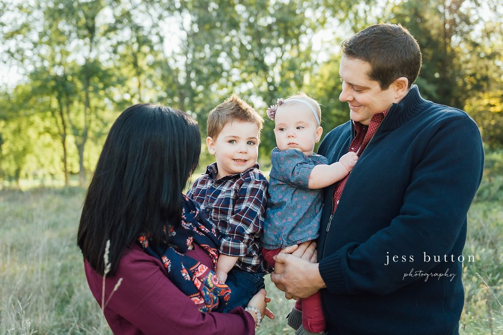 Niagara Family Photographer - Fall family portraits Niagara-on-the-Lake - parents with two children standing in field