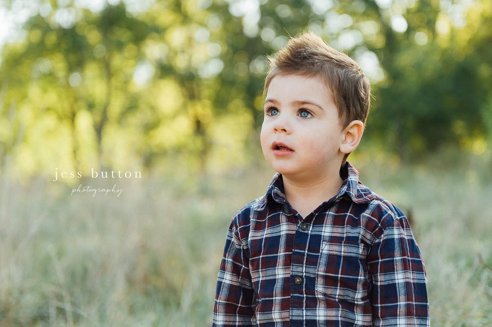 Niagara Family Photographer - Fall family portraits Niagara-on-the-Lake - two year old boy candid photo