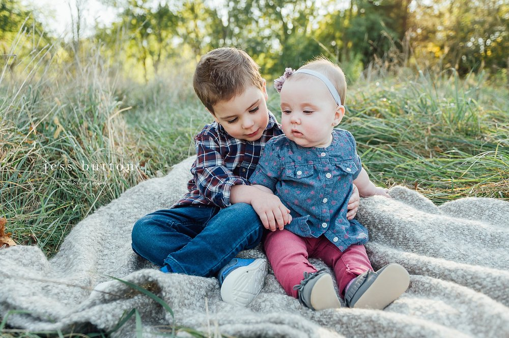 Niagara Family Photographer - Fall family portraits Niagara-on-the-Lake - two year old boy and 10 month old baby girl sitting together