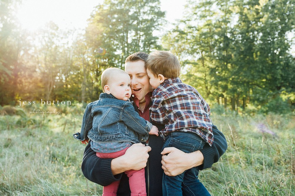 Niagara Family Photographer - Fall family portraits Niagara-on-the-Lake - dad holding baby girl and little boy
