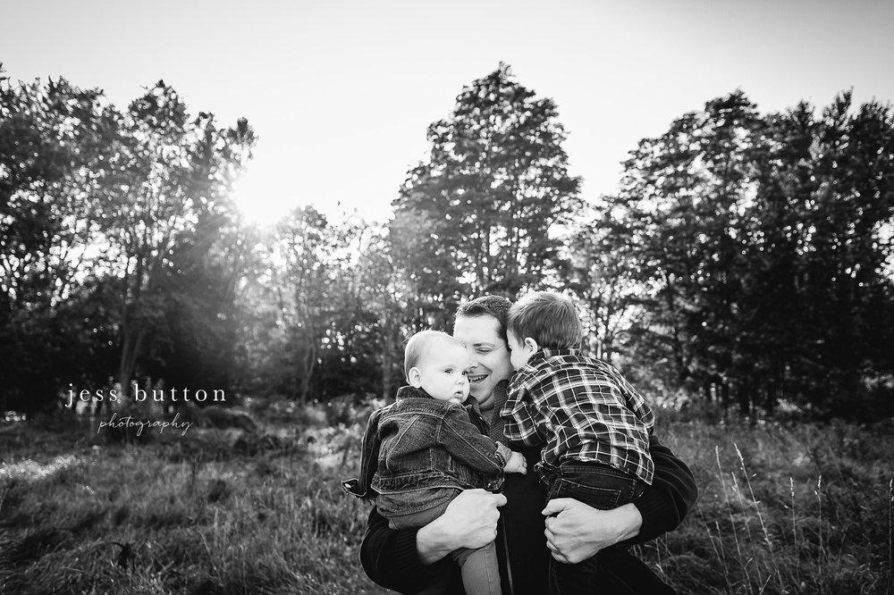 Niagara Family Photographer - Fall family portraits Niagara-on-the-Lake - dad holding baby girl and little boy