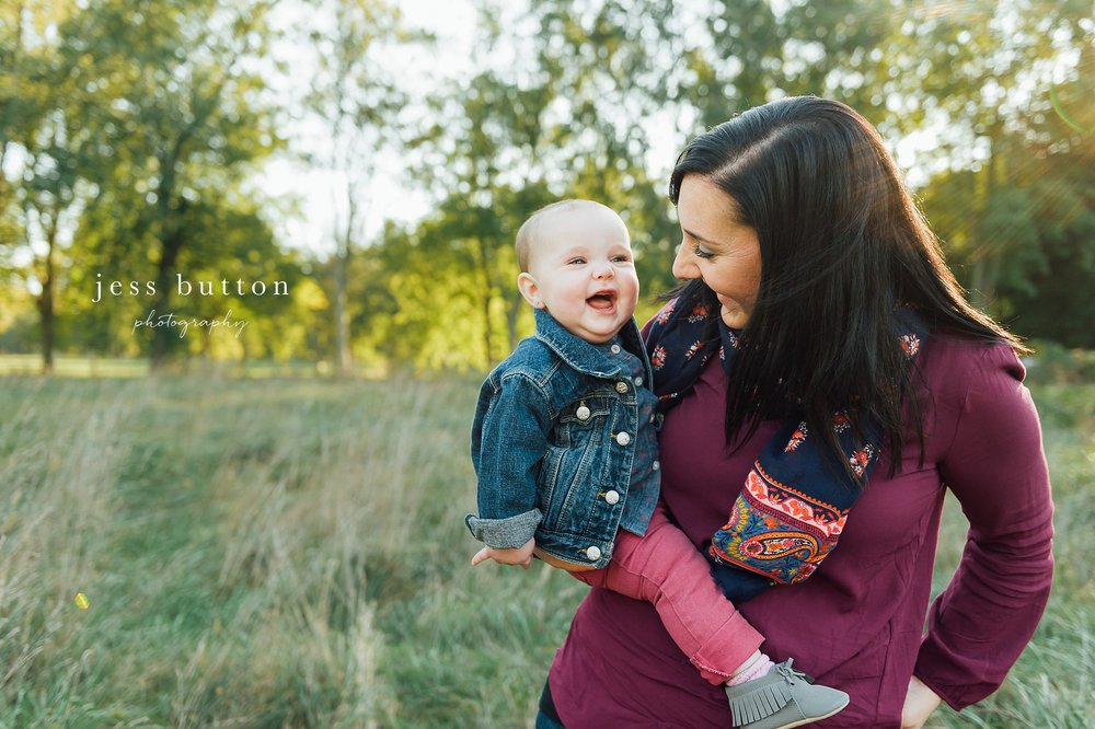 Niagara Family Photographer - Fall family portraits Niagara-on-the-Lake - mom with 10 month old baby girl smiling in field