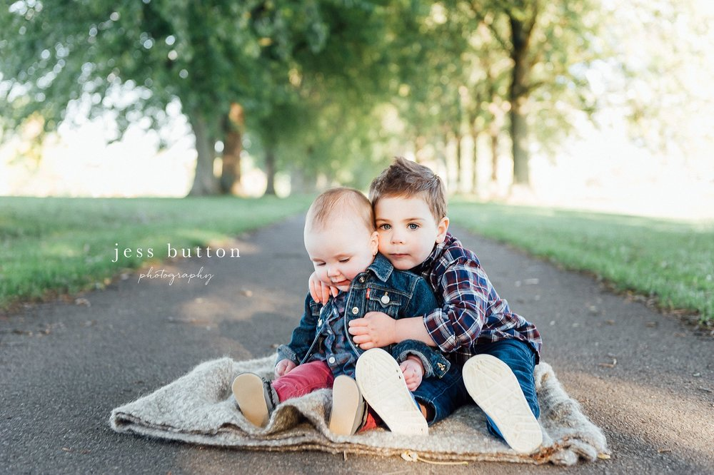 Niagara Family Photographer - Fall family portraits Niagara-on-the-Lake - brother and sister sitting together on path