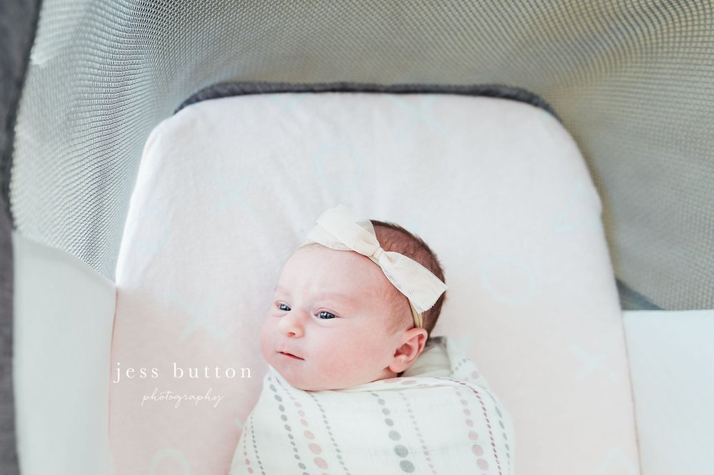 Niagara Newborn Lifestyle Photographer - baby girl with parents at home in St Catharines