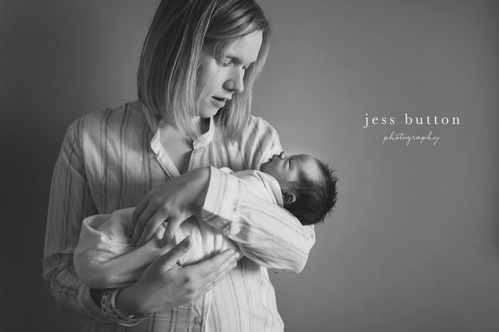 new mom holding baby boy in St Catharines hospital for fresh 48 newborn photos