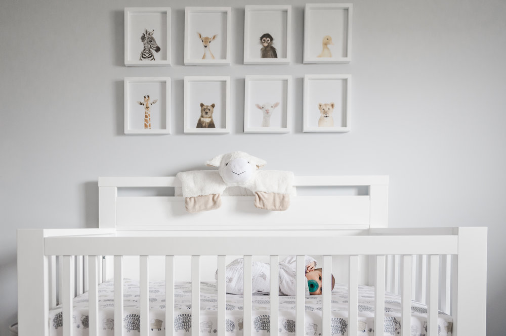 baby boy in crib at home in niagara with newborn photographer