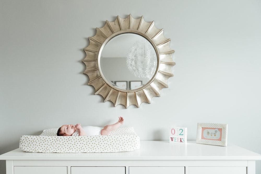 nursery with two week old baby girl in Niagara home