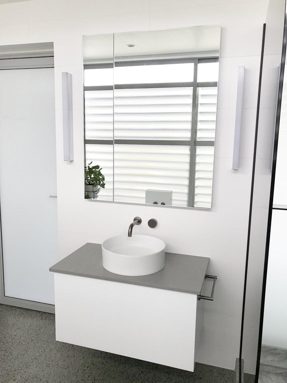Sleek sink with a wide mirror