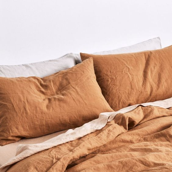 Tobacco and Nude bed linen.