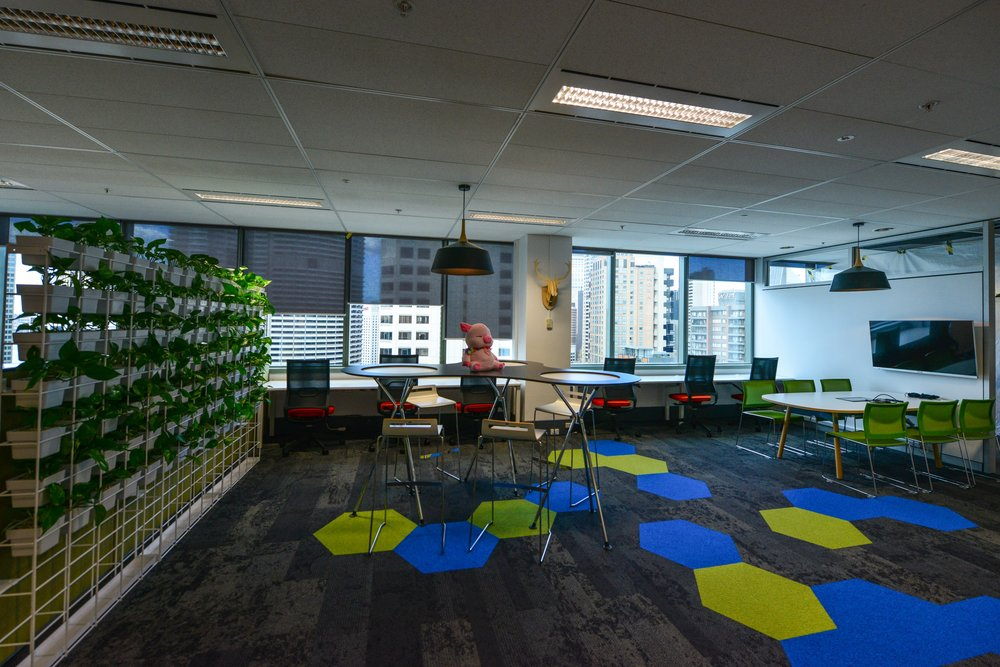 Office workstations on a hexagon patterned carpet