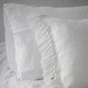 Fringed pillowcase detail.