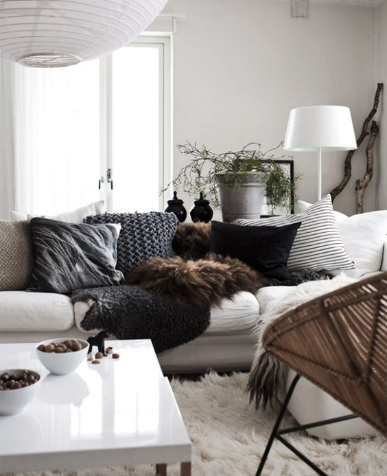 Winter Scheme : Fur throws, Heavy knit and strong textured cushions, with a big fluffy rug for good measure.