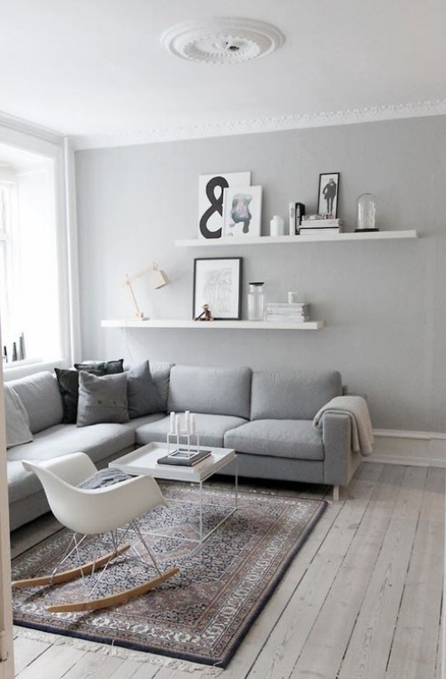 A light colour scheme with soft grey walls and sanded floors. The white floating shelves 'pop' against the soft grey and provide a great opportunity to add personal pieces in a non cluttered way. The rug adds texture and pattern to a fairly minimal scheme.