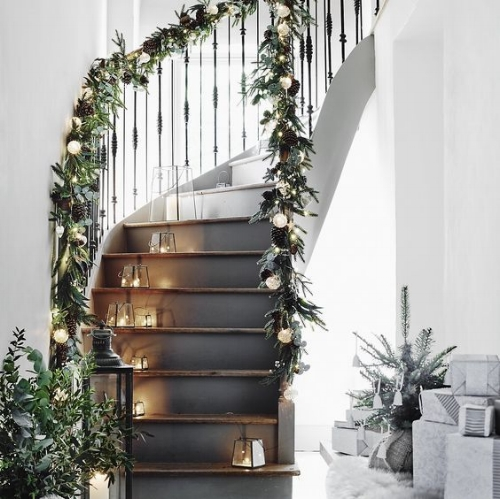 The Stairs - I love this staircase! doesn't it look magical with the foliage and twinkle lights wrapped around!