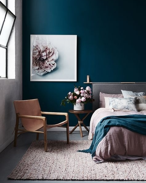 Theres that Teal colour again! This time with a more muted pallet. Blush pink compliments this shade perfectly and large windows provide some much needed light with a ceiling this high.