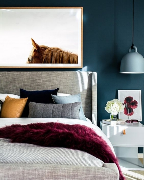 We are loving Teal at the moment. These beautiful jewel tones create a rich, warm and welcoming environment, ideal in a cozy bedroom! A simple art piece like this breaks up the darkness of the wall and helps reflect light.
