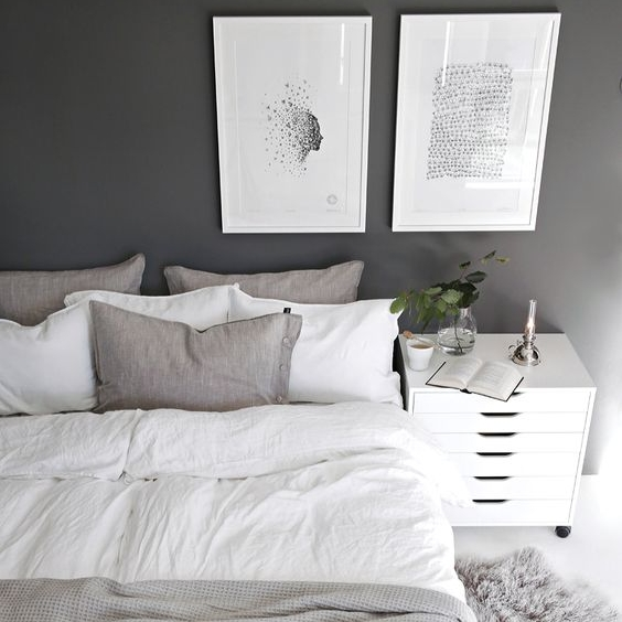 White textured bed linen looks so classy against this charcoal wall. White wash floor boards provide some contrast and light.