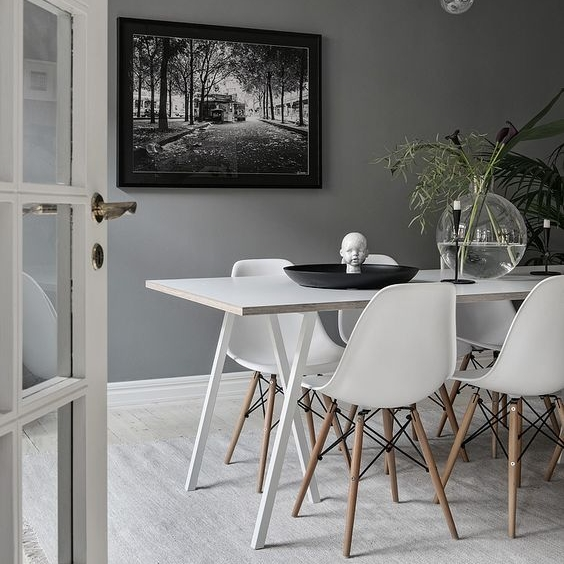 Once again this grey tone wall looks stunning against the white furniture. This whole dining suite stands out by itself with very little styling!