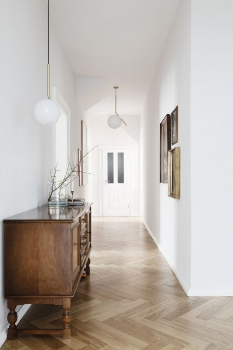 I think this is a great example of using the one colour technique - this long, narrow hallway feels large and bright by using all one shade of white. The colour makes the hallway appear much more spacious than what it really is by blurring lines.