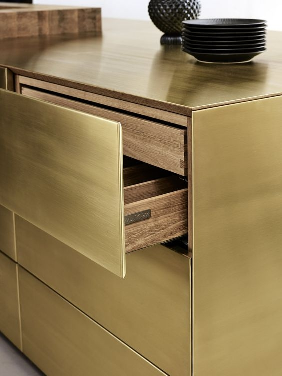 Brass draw fronts and side panels with a wood veneer detail on the interior, it doesn't get more show stopping than this!
