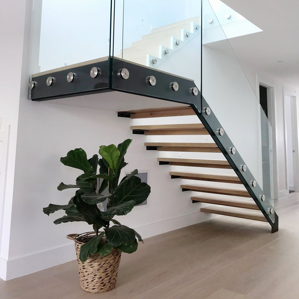 glass, steel and oak floating stairs.
