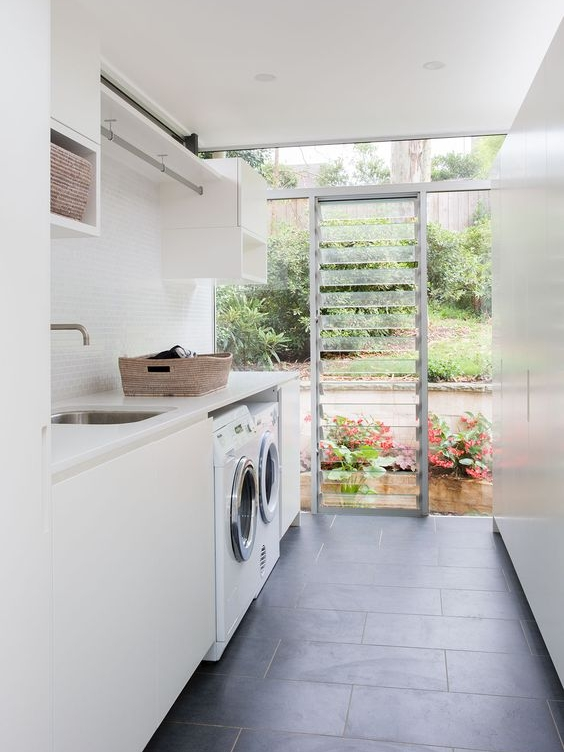 I think these louvers are such a wonderful idea for laundries! they provide fantastic ventilation. I always like to include a hanging rail where possible just like they have done, it is so handy in colder months to be able to hang things indoors, even better when hung over the sink so any drips don't sit on the bench top.